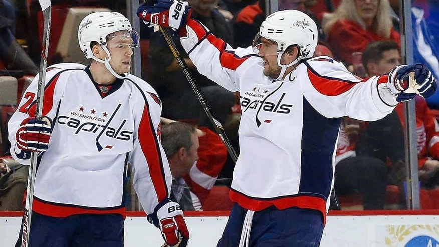 <p>Washington Capitals center Evgeny Kuznetsov, left, celebrates his game winning goal in overtime against the Detroit Red Wings with Alex Ovechkin during an NHL hockey game, Wednesday, Nov. 18, 2015 in Detroit. (AP Photo/Paul Sancya)</p>