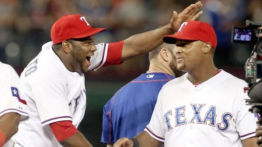 The Texas Rangers' Hanser Alberto, left, pats Adrian Beltre on the head as they celebrate a 5-3 win against the Los Angeles Angels at Globe Life Park in Arlington, Texas, on Thursday, Oct. 1, 2015. (Richard W. Rodriguez/Fort Worth Star-Telegram/TNS via Getty Images)