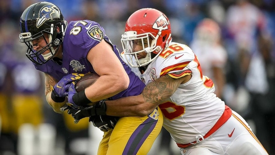 Kansas City Chiefs inside linebacker Derrick Johnson (56) tackles Baltimore Ravens tight end Maxx Williams (87) in the fourth quarter on Sunday, Dec. 20, 2015, at M&T Bank Stadium in Baltimore, Md. The Chiefs won, 34-14. (David Eulitt/Kansas City Star/TNS via Getty Images)