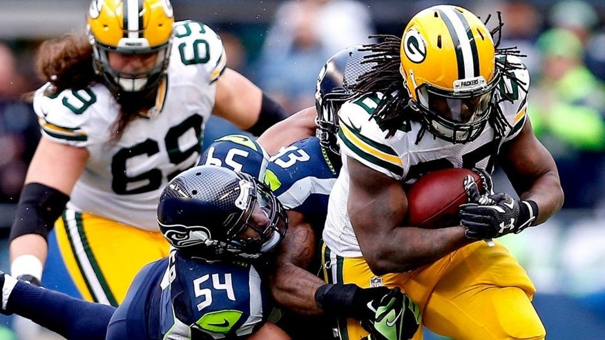 SEATTLE, WA - JANUARY 18: Eddie Lacy #27 of the Green Bay Packers runs the ball in the second half against the Seattle Seahawks during the 2015 NFC Championship game at CenturyLink Field on January 18, 2015 in Seattle, Washington. (Photo by Christian Petersen/Getty Images)