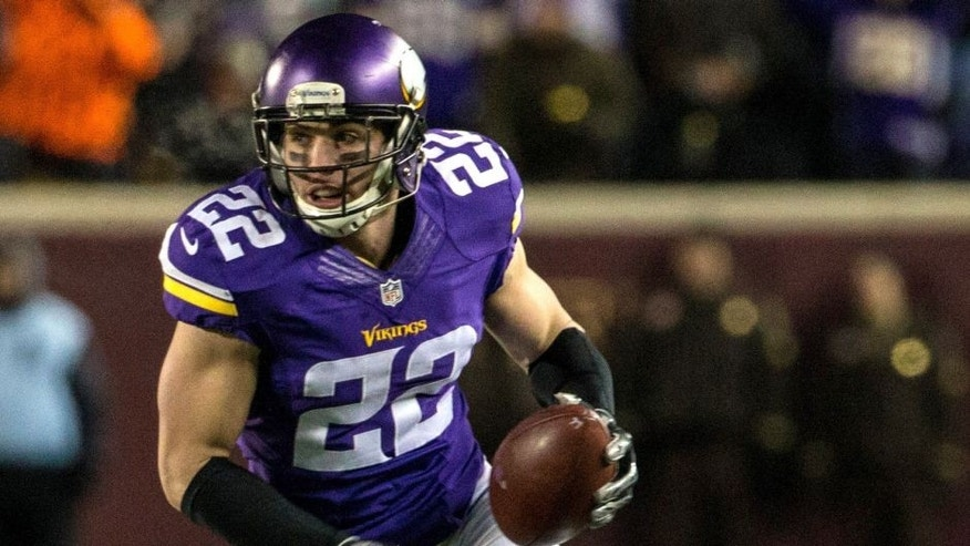 Dec 27, 2015; Minneapolis, MN, USA; Minnesota Vikings safety Harrison Smith (22) returns an interception for a touchdown during the second quarter against the New York Giants at TCF Bank Stadium. Mandatory Credit: Brace Hemmelgarn-USA TODAY Sports