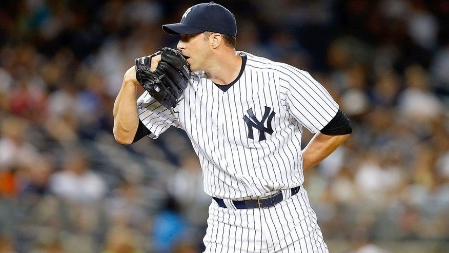 NEW YORK, NY - AUGUST 20: Chris Capuano #26 of the New York Yankees in action against the Cleveland Indians at Yankee Stadium on August 20, 2015 in the Bronx borough of New York City. The Indians defeated the Yankees 3-2. (Photo by Jim McIsaac/Getty Images)