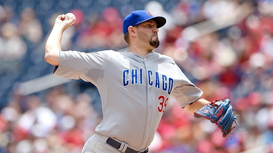 Chicago Cubs starting pitcher Jason Hammel delivers a pitch against the Washington Nationals during the first inning of a baseball game, Saturday, June 6, 2015, in Washington. (AP Photo/Nick Wass)