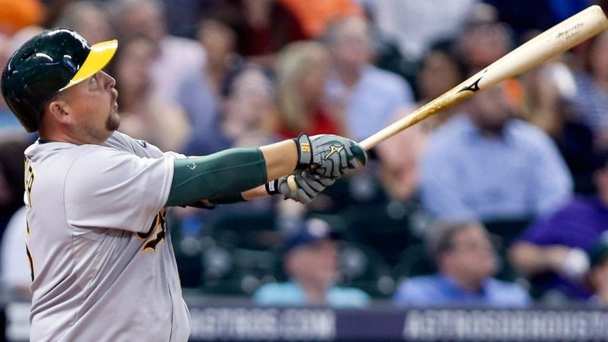 Apr 13, 2015; Houston, TX, USA; Oakland Athletics designated hitter Billy Butler (16) hits a home run during the fifth inning against the Houston Astros at Minute Maid Park. Mandatory Credit: Troy Taormina-USA TODAY Sports