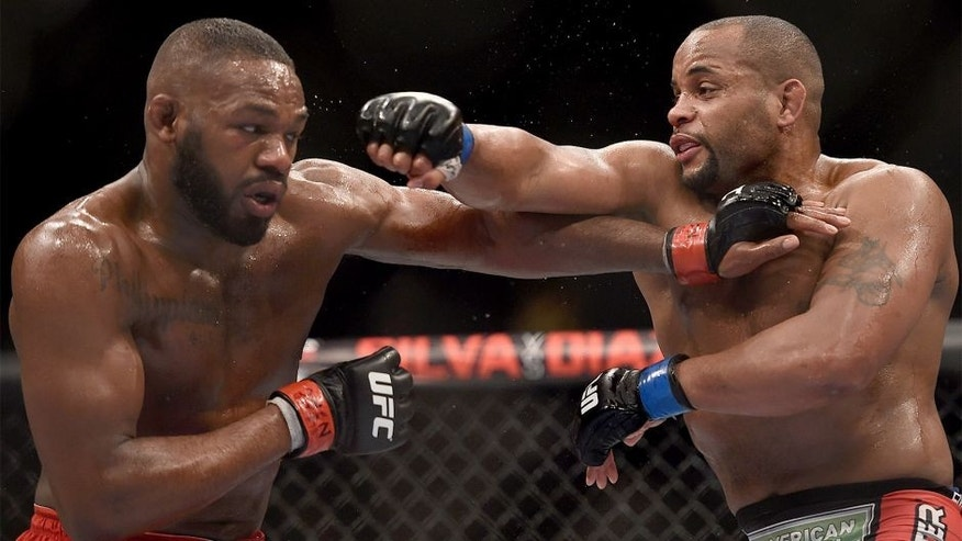 LAS VEGAS, NV - JANUARY 03: Jon Jones (L) and Daniel Cormier (R) exchange punches in their UFC light heavyweight championship bout during the UFC 182 event at the MGM Grand Garden Arena on January 3, 2015 in Las Vegas, Nevada. (Photo by Jeff Bottari/Zuffa LLC/Zuffa LLC via Getty Images)