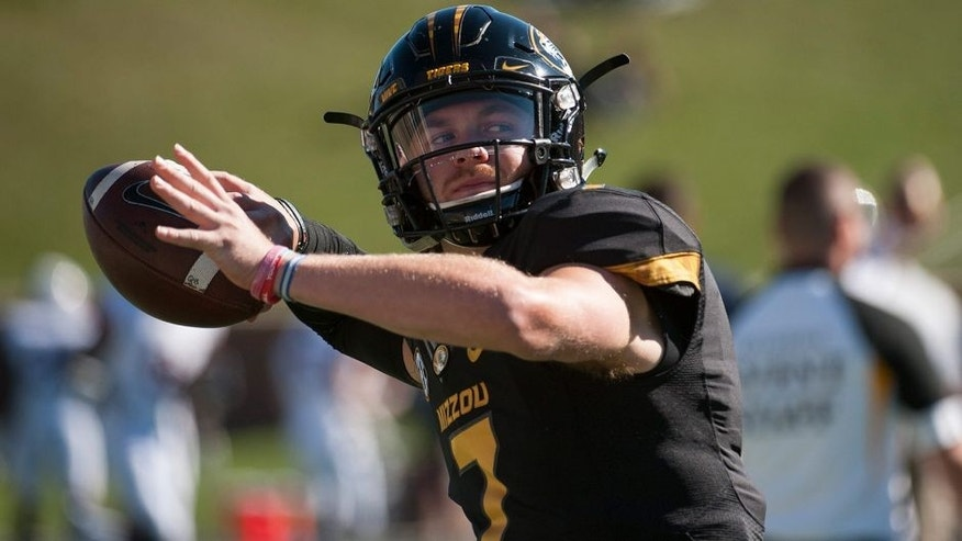 Missouri quarterback Maty Mauk warms up before the start of an NCAA college football game against Connecticut Saturday, Sept. 19, 2015, in Columbia, Mo. (AP Photo/L.G. Patterson)