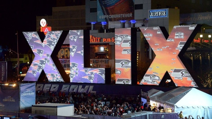 Jan 28, 2015; Phoenix, AZ, USA; General view of the Super Bowl XLIX roman numerals with the logos of the Seattle Seahawks and the New England Patriots at Super Bowl Central. Mandatory Credit: Kirby Lee-USA TODAY Sports