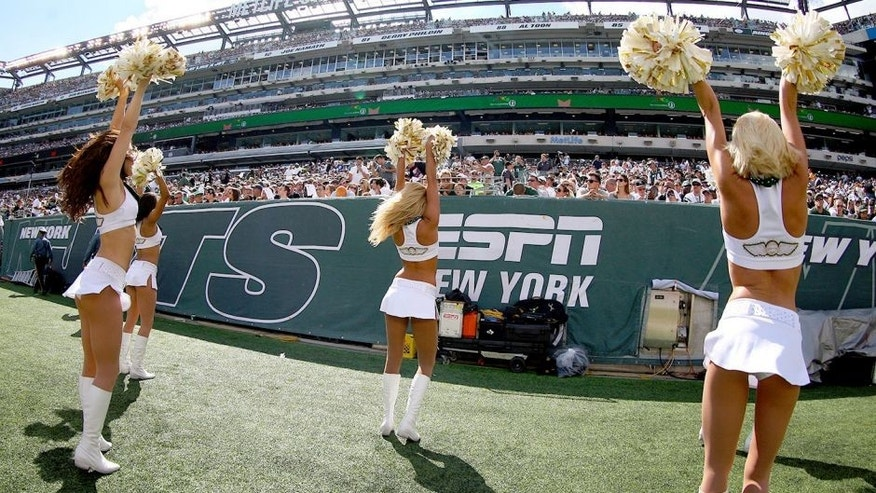 EAST RUTHERFORD, NJ - SEPTEMBER 07: The New York Jets Flight Crew cheerleaders perform during the fourth quarter of a game between the New York Jets and the Oakland Raiders at MetLife Stadium on September 7, 2014 in East Rutherford, New Jersey. (Photo by Ed Mulholland/Getty Images)