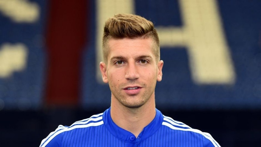 Schalke's defender Matija Nastasic poses during the team presentation of Schalke 04 on July 17, 2015 in Gelsenkirchen, western Germany. AFP PHOTO / PATRIK STOLLARZ (Photo credit should read PATRIK STOLLARZ/AFP/Getty Images)