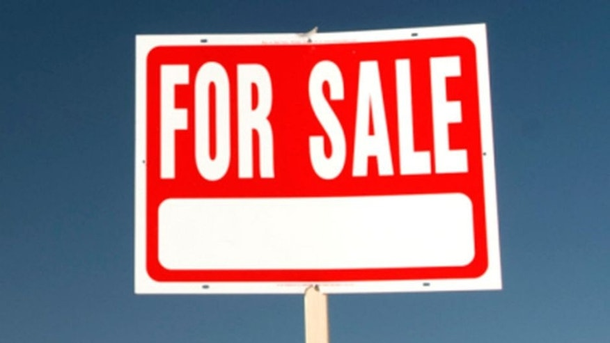 For sale sign in barren landscape.