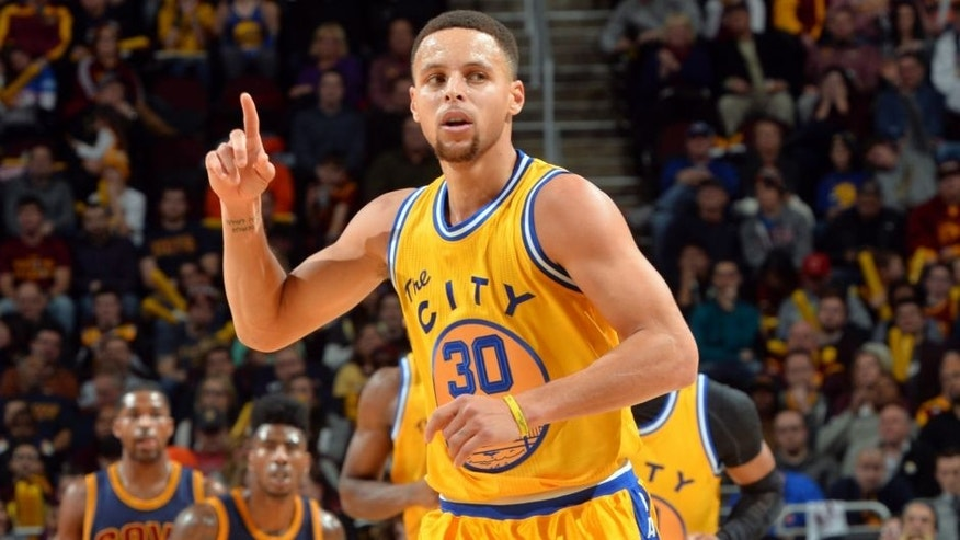 CLEVELAND, OH - JANUARY 18: Stephen Curry #30 of the Golden State Warriors raises his hand during a break in the action against the Cleveland Cavaliers on January 18, 2016 at Quicken Loans Arena in Cleveland, Ohio. (Jesse D. Garrabrant/NBAE via Getty Images)