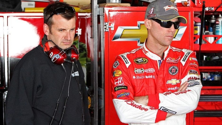 Sep 26, 2014; Dover, DE, USA; NASCAR Sprint Cup driver Kevin Harvick and NASCAR Sprint Cup Series crew chief Rodney Childers stand in the garage during practice for the AAA 400 at Dover International Speedway. Mandatory Credit: Matthew O'Haren-USA TODAY Sports