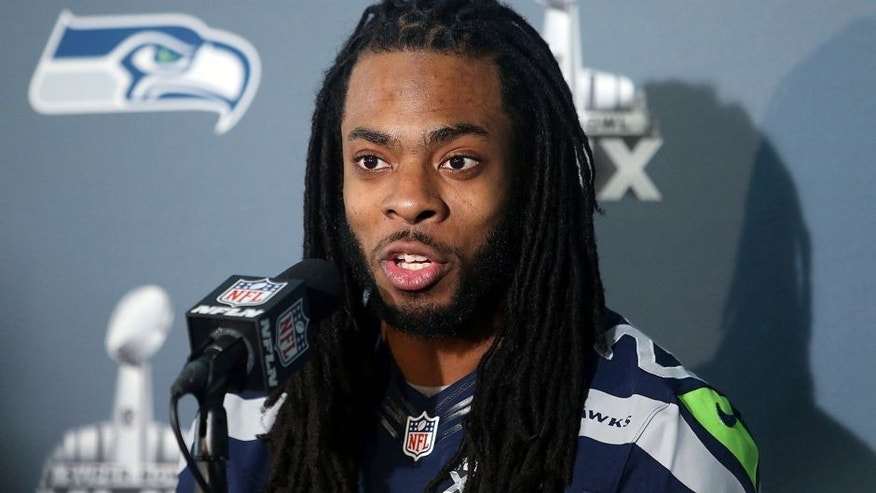 Jan 28, 2015; Phoenix, AZ, USA; Seattle Seahawks cornerback Richard Sherman talks to reporters during the Seattle Seahawks press conference at Arizona Grand. Mandatory Credit: Peter Casey-USA TODAY Sports