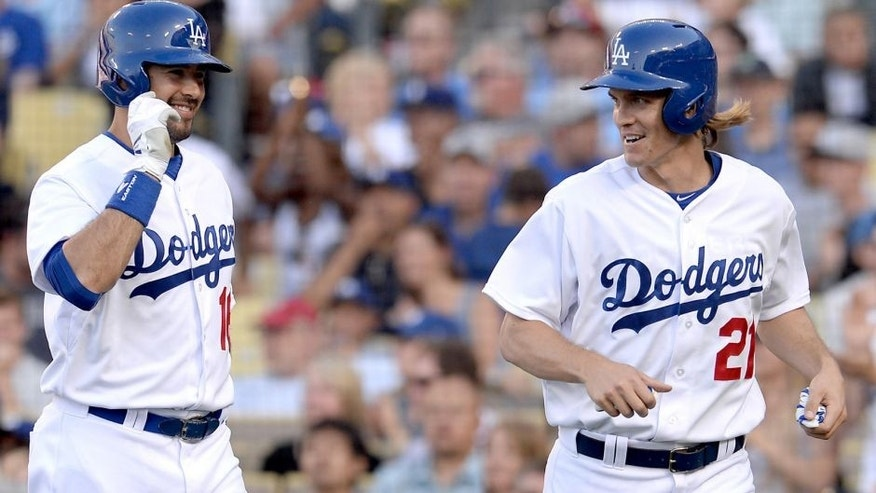 Jun 7, 2015; Los Angeles, CA, USA; Los Angeles Dodgers starting pitcher Zack Greinke (21) is met by right fielder Andre Ethier (16) after he crossed the plate for a run off a single by third baseman Justin Turner (10) in the third inning of the game against the St. Louis Cardinals at Dodger Stadium. Mandatory Credit: Jayne Kamin-Oncea-USA TODAY Sports