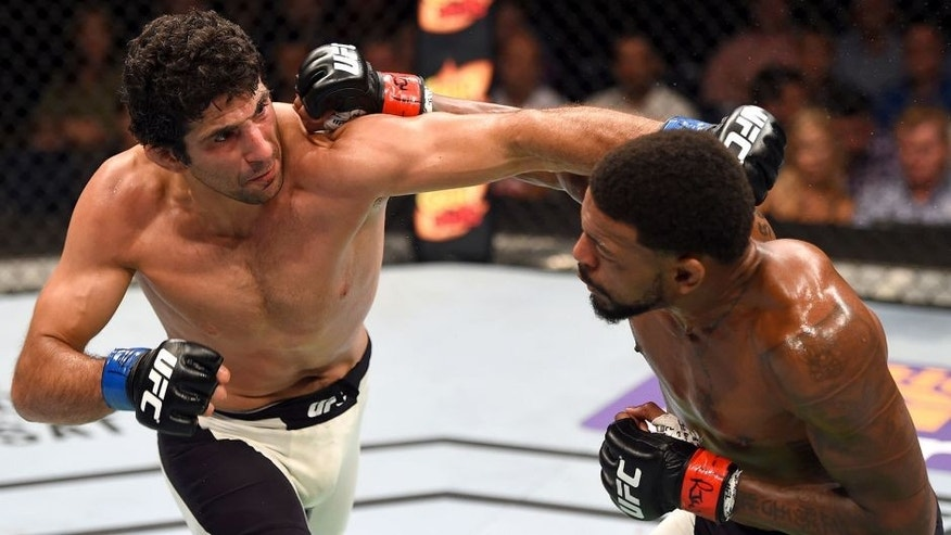 NASHVILLE, TN - AUGUST 08: (L-R) Beneil Dariush punches Michael Johnson in their lightweight bout during the UFC Fight Night event at Bridgestone Arena on August 8, 2015 in Nashville, Tennessee. (Photo by Josh Hedges/Zuffa LLC/Zuffa LLC via Getty Images)