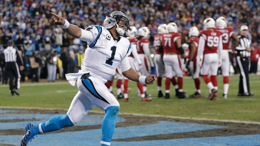 File - In this Jan. 24, 2016, file photo, Carolina Panthers' Cam Newton celebrates his touchdown run during the first half the NFL football NFC Championship game against the Arizona Cardinals, in Charlotte, N.C.