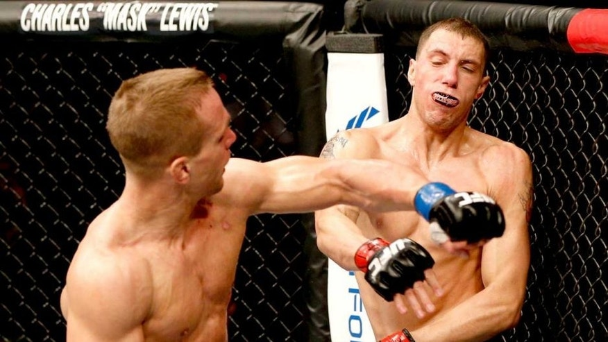 AUSTIN, TX - NOVEMBER 22: (L-R) Nick Hein of Germany punches James Vick in their lightweight bout during the UFC Fight Night event at The Frank Erwin Center on November 22, 2014 in Austin, Texas. (Photo by Josh Hedges/Zuffa LLC/Zuffa LLC via Getty Images)
