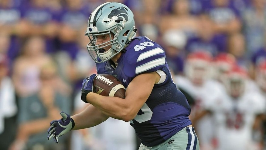 MANHATTAN, KS - SEPTEMBER 05: Full back Glenn Gronkowski #48 of the Kansas State Wildcats runs up field against the South Dakota Coyotes during the first half on September 5, 2015 at Bill Snyder Family Stadium in Manhattan, Kansas. (Photo by Peter G. Aiken/Getty Images)