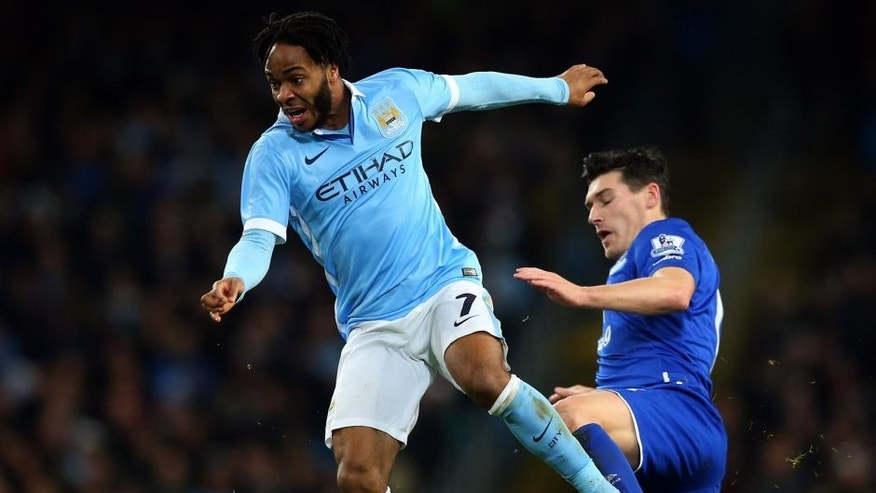 MANCHESTER, ENGLAND - JANUARY 27: Raheem Sterling of Manchester City is tackled by Gareth Barry of Everton during the Capital One Cup Semi Final, second leg match between Manchester City and Everton at the Etihad Stadium on January 27, 2016 in Manchester, England. (Photo by Alex Livesey/Getty Images)