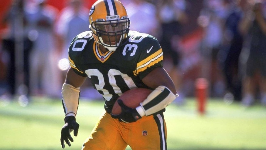 24 Sep 2000: Ahman Green #30 of the Green Bay Packers runs with the ball during the game against the Arizona Cardinals at the Sun Devil Stadium in Tempe, Arizona. The Packers defeated the Cardinals 29-3.Mandatory Credit: Harry How /Allsport