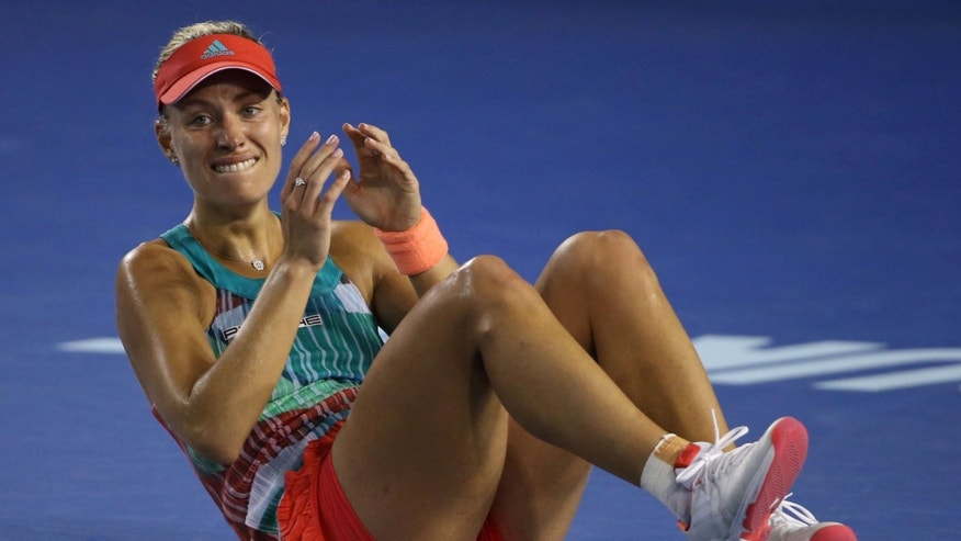 Jan. 30, 2016: Angelique Kerber of Germany celebrates after defeating Serena Williams of the United States in the women's singles final at the Australian Open tennis championships in Melbourne, Australia.