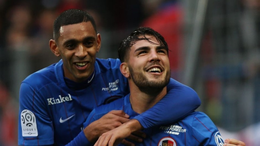 Caen's French forward Andy Delort (R) is congratulated by Caen's French forward Ronny Rodelin after scoring a penalty kick during the French L1 football match between Caen (SM Caen) and Nice (OGC Nice) on January 31, 2016 at the Michel d'Ornano stadium in Caen. AFP PHOTO / CHARLY TRIBALLEAU / AFP / CHARLY TRIBALLEAU (Photo credit should read CHARLY TRIBALLEAU/AFP/Getty Images)