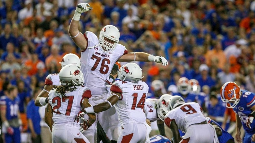 Oct 5, 2013; Gainesville, FL, USA; Arkansas Razorbacks offensive tackle Dan Skipper (76) reacts after blocking a field goal during the first half of the game against the Florida Gators at Ben Hill Griffin Stadium. Mandatory Credit: Rob Foldy-USA TODAY Sports