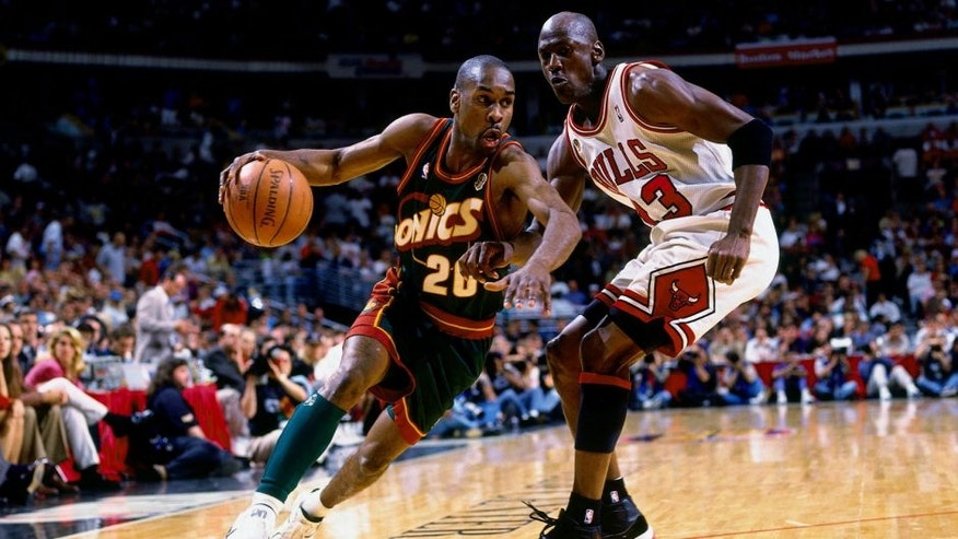 <p>CHICAGO - JUNE 16: Gary Payton #20 of the Seattle SuperSonics drives to the basket against Michael Jordan #23 of the Chicago Bulls during Game Six of the 1996 NBA Finals at the United Center on June 16, 1996 in Chicago Iillinois. The Bulls won 87-75. NOTE TO USER: User expressly acknowledges that, by downloading and or using this photograph, User is consenting to the terms and conditions of the Getty Images License agreement. Mandatory Copyright Notice: Copyright 1996 NBAE (Photo by Andy Hayt/NBAE via Getty Images)</p>