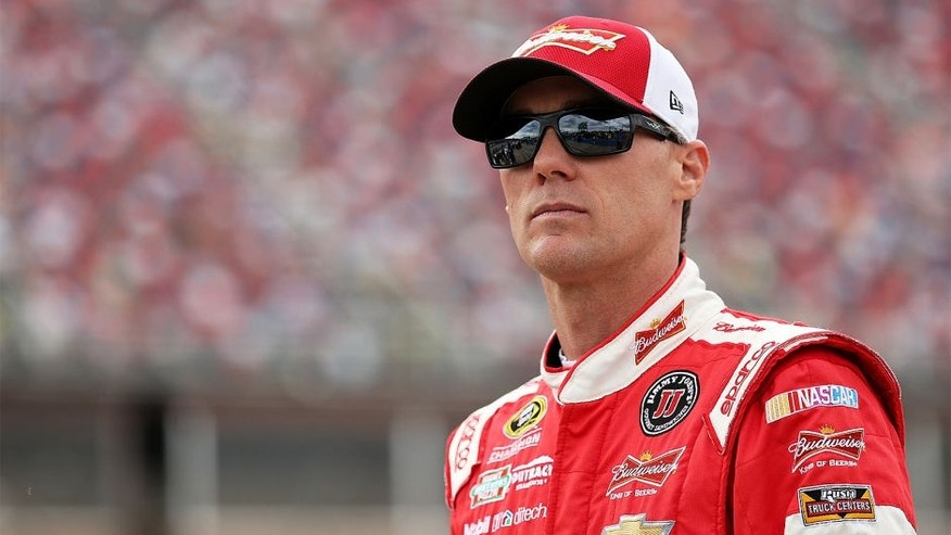 TALLADEGA, AL - OCTOBER 24: Kevin Harvick, driver of the #4 Budweiser/Jimmy John's Chevrolet, stands on the grid during qualifying for the NASCAR Sprint Cup Series CampingWorld.com 500 at Talladega Superspeedway on October 24, 2015 in Talladega, Alabama. (Photo by Patrick Smith/Getty Images)