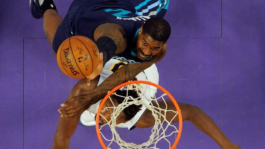 Jan 31, 2016; Los Angeles, CA, USA; Charlotte Hornets forward Marvin Williams (2) shoots the ball against Los Angeles Lakers forward Julius Randle (30) at Staples Center. Mandatory Credit: Richard Mackson-USA TODAY Sports