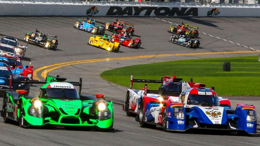 DAYTONA BEACH, FL - JANUARY 30: Prototype cars race into turn one at the start of the Rolex 24 at Daytona at Daytona International Speedway on January 30, 2016 in Daytona Beach, Florida. (Photo by Brian Cleary/Getty Images)