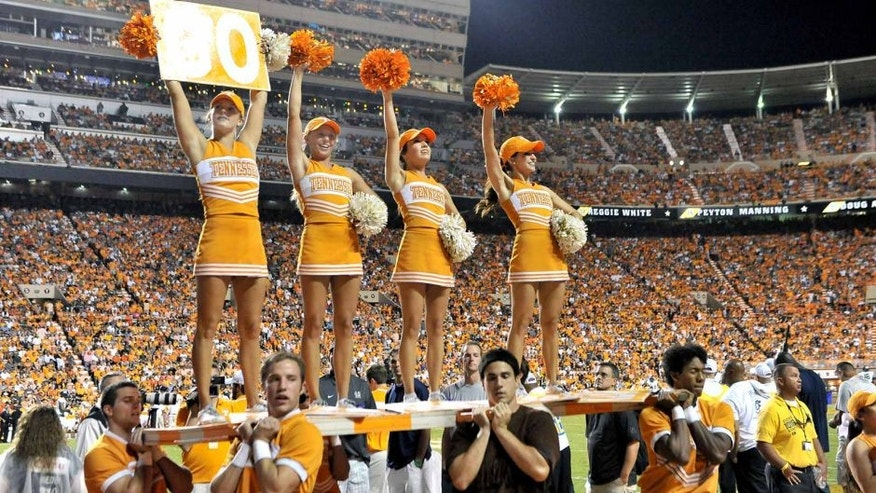Aug 31, 2014; Knoxville, TN, USA; Tennessee Volunteers cheerleaders entertain fans during the first half against the Utah State Aggies at Neyland Stadium. Mandatory Credit: Jim Brown-USA TODAY Sports
