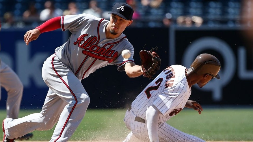 San Diego Padres' Melvin Upton Jr. beats the throw to Atlanta Braves second baseman Jace Peterson while stealing second during the seventh inning of a baseball game Wednesday, Aug. 19, 2015, in San Diego. (AP Photo/Lenny Ignelzi)
