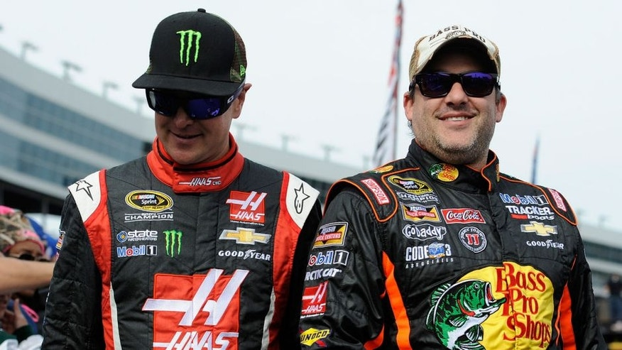 FORT WORTH, TX - NOVEMBER 02: Kurt Busch, driver of the #41 Haas Automation Chevrolet, and Tony Stewart, driver of the #14 Bass Pro Shops / Mobil 1 Chevrolet, during the NASCAR Sprint Cup Series AAA Texas 500 at Texas Motor Speedway on November 2, 2014 in Fort Worth, Texas. (Photo by Jared C. Tilton/NASCAR via Getty Images)