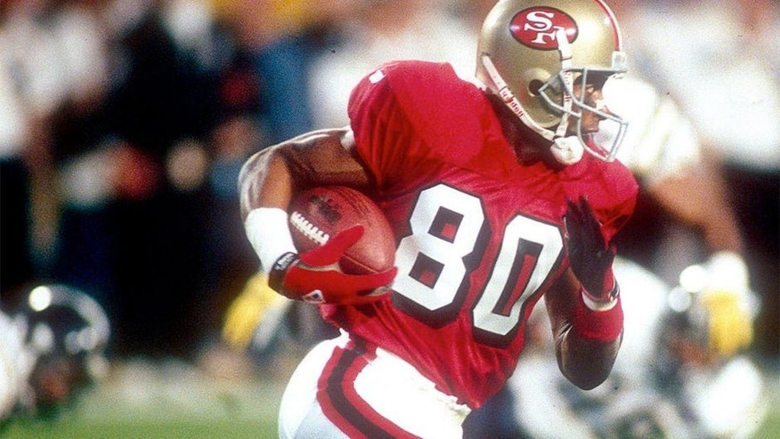 <p>Wider receiver Jerry Rice #80 of the San Francisco 49ers runs with the ball after a catch against the San Diego Chargers during Super Bowl XXIX on January 29, 1995 at Joe Robbie Stadium in Miami, Florida. The 49ers won the Super Bowl 49-26.</p>