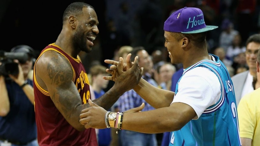 CHARLOTTE, NC - NOVEMBER 27: (L-R) LeBron James #23 of the Cleveland Cavaliers talks to Cam Newton, quarterback of the Carolina Panthers after the Cavaliers defeated the Hornets 95-90 at Time Warner Cable Arena on November 27, 2015 in Charlotte, North Carolina. NBA - NOTE TO USER: User expressly acknowledges and agrees that, by downloading and or using this photograph, User is consenting to the terms and conditions of the Getty Images License Agreement. (Photo by Streeter Lecka/Getty Images)