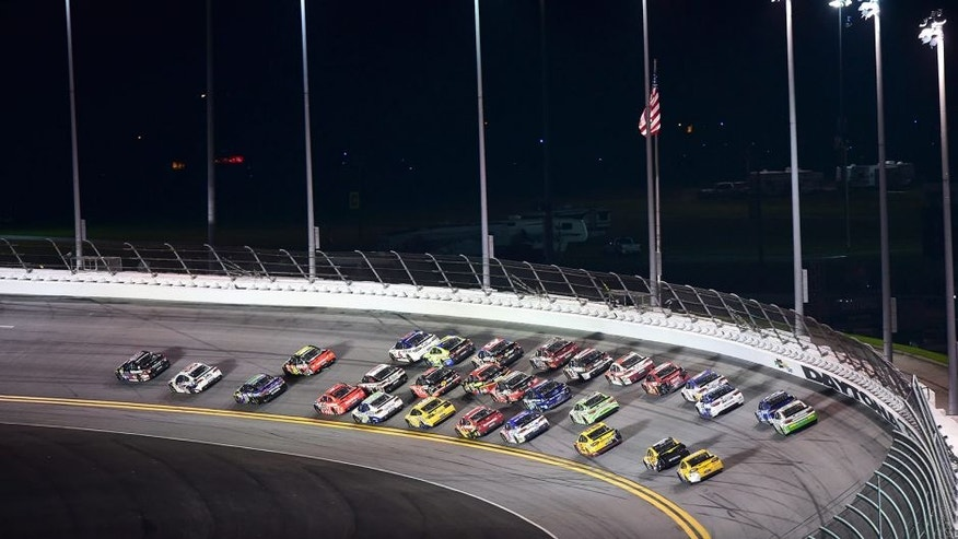 Drivers race during the NASCAR Sprint Cup Series Coke Zero 400 Powered by Coca-Cola at Daytona International Speedway on July 6, 2015 in Daytona Beach, Florida.