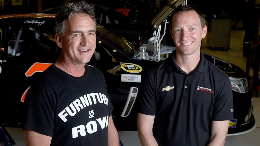DENVER, CO - JUNE 08: Furniture Row Racing crew chief Cole Pearn (right) and general manager Joe Garone pose at the Furniture Row Racing shop on Monday, June 8, 2015. Team driver Martin Truex Jr. won the Axalta 400 at Pocono Raceway on Sunday. (Photo by AAron Ontiveroz/The Denver Post via Getty Images)