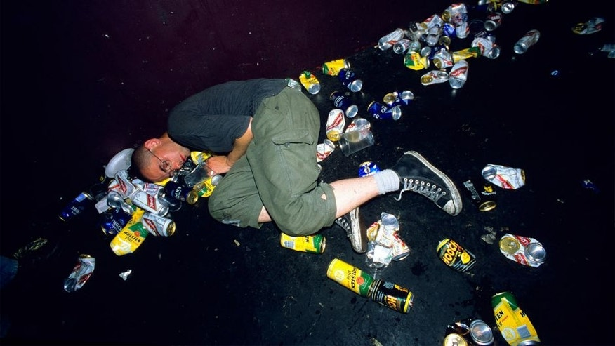 Punk asleep amoungst litter and beer cans on the floor at a gig. London Astoria 1998. (Photo by: PYMCA/UIG via Getty Images)
