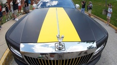 In this photo made with a fisheye lens, Pittsburgh Steelers wide receiver Antonio Brown arrives in a custom Steelers-themed Rolls Royce for NFL football training camp at the team's training facility in Latrobe, Pa., Saturday, July 25, 2015. (AP Photo/Keith Srakocic)