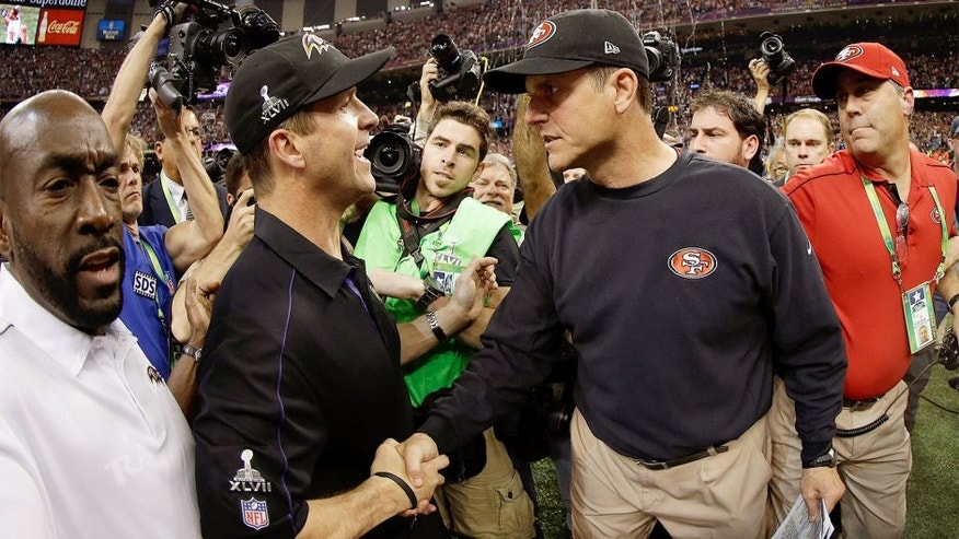 NEW ORLEANS, LA - FEBRUARY 03: Head coach John Harbaugh of the Baltimore Ravens shakes hands with his brother head coach Jim Harbaugh of the San Francisco 49ers after winning Super Bowl XLVII at the Mercedes-Benz Superdome on February 3, 2013 in New Orleans, Louisiana. The Ravens defeated the 49ers 34-31. (Photo by Ezra Shaw/Getty Images)