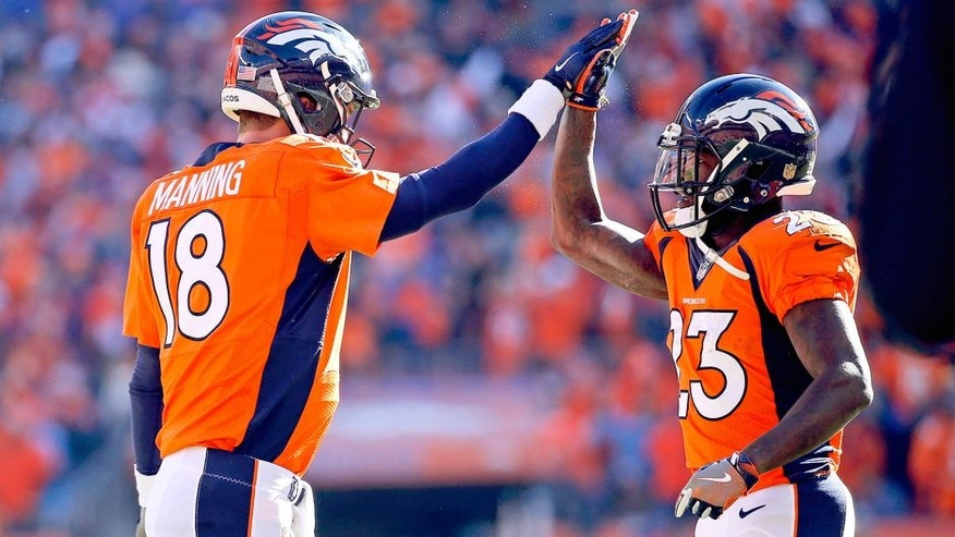 Jan 24, 2016; Denver, CO, USA; Denver Broncos quarterback Peyton Manning (18) celebrates with running back Ronnie Hillman (23) during the game against the New England Patriots in the AFC Championship football game at Sports Authority Field at Mile High. Mandatory Credit: Kevin Jairaj-USA TODAY Sports