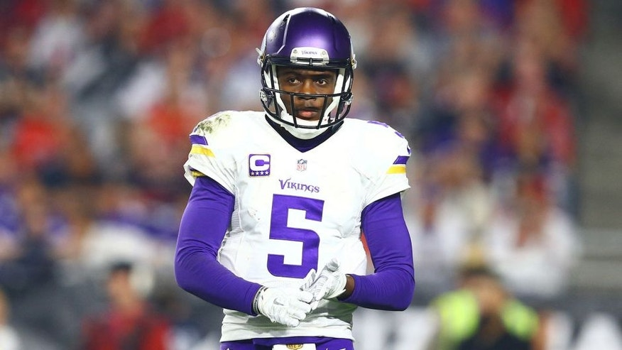 Dec 10, 2015; Glendale, AZ, USA; Minnesota Vikings quarterback Teddy Bridgewater (5) reacts in the second half against the Arizona Cardinals at University of Phoenix Stadium. The Cardinals defeated the Vikings 23-20. Mandatory Credit: Mark J. Rebilas-USA TODAY Sports