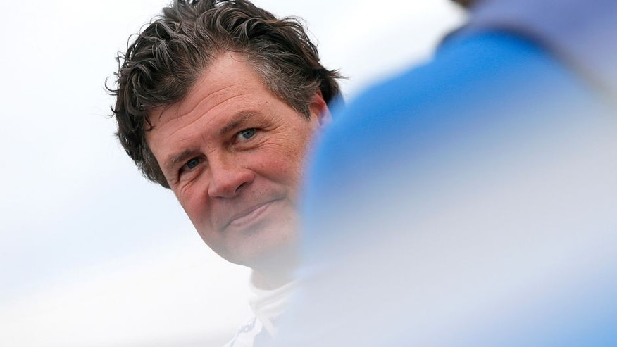 TALLADEGA, AL - OCTOBER 24: Michael Waltrip, driver of the #98 Maxwell House Toyota, stands on the grid during qualifying for the NASCAR Sprint Cup Series CampingWorld.com 500 at Talladega Superspeedway on October 24, 2015 in Talladega, Alabama. (Photo by Brian Lawdermilk/Getty Images)