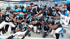 Dec 13, 2015; Charlotte, NC, USA; Carolina Panthers dab late in the game. The Panthers defeated the Falcons 38-0 at Bank of America Stadium. Mandatory Credit: Bob Donnan-USA TODAY Sports