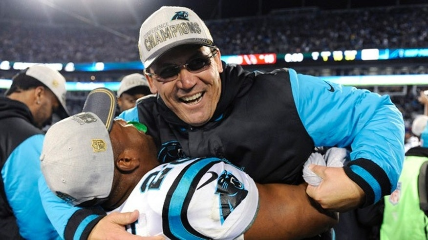 Carolina Panthers head coach Ron Rivera celebrates with Jonathan Stewart after the NFL football NFC Championship game against the Arizona Cardinals, Sunday, Jan. 24, 2016, in Charlotte, N.C. The Panthers won 49-15 to advance to the Super Bowl. (AP Photo/Mike McCarn)