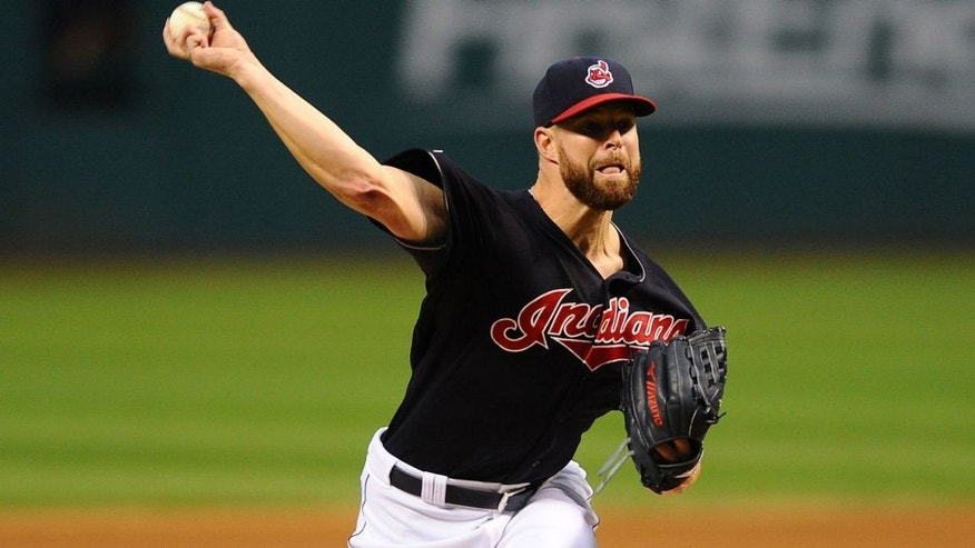Sep 28, 2015; Cleveland, OH, USA; Cleveland Indians starting pitcher Corey Kluber (28) throws a pitch during the first inning against the Minnesota Twins at Progressive Field.