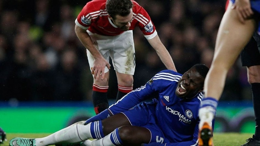 Chelsea's French defender Kurt Zouma clutches his knee during the English Premier League football match between Chelsea and Manchester United at Stamford Bridge in London on February 7, 2016. / AFP / ADRIAN DENNIS / RESTRICTED TO EDITORIAL USE. No use with unauthorized audio, video, data, fixture lists, club/league logos or 'live' services. Online in-match use limited to 75 images, no video emulation. No use in betting, games or single club/league/player publications. / (Photo credit should read ADRIAN DENNIS/AFP/Getty Images)
