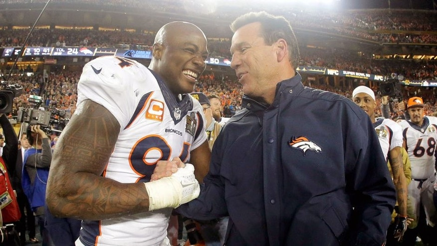 Denver Broncos' DeMarcus Ware (94) and Denver Broncos' head coach Gary Kubiak celebrate after their win against the Carolina Panthers in the NFL Super Bowl 50 football game Sunday, Feb. 7, 2016, in Santa Clara, Calif. The Broncos won 24-10. (AP Photo/Julio Cortez)