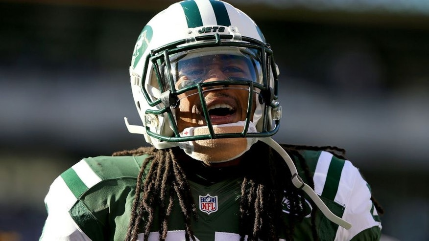 EAST RUTHERFORD, NJ - NOVEMBER 29: Calvin Pryor #25 of the New York Jets celebrates a tackle in the first quarter against the Miami Dolphins on November 29, 2015 at MetLife Stadium in East Rutherford, New Jersey. (Photo by Elsa/Getty Images)